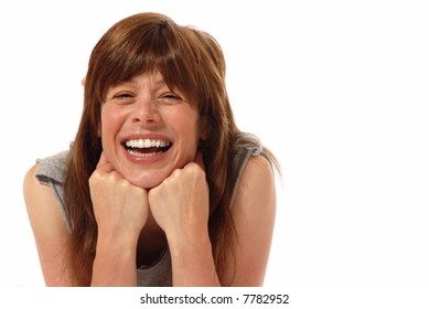laughing pretty young woman on white - room for text