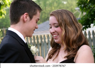 Laughing Prom Girl Fixing Boutonniere
