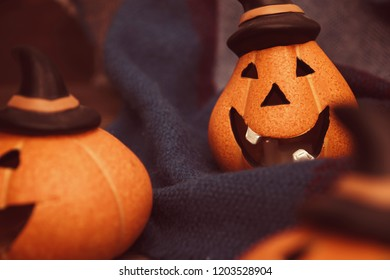 laughing pumpkins for Halloween on a warm cozy blanket Halloween symbol