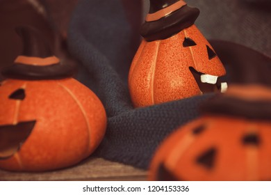 laughing pumpkins for Halloween on a warm cozy blanket Halloween symbol.