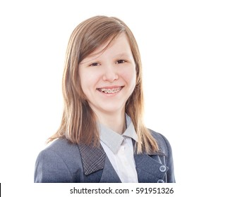 Laughing school girl wearing braces looking at camera isolated