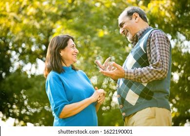 Laughing senior couple spending leisure time