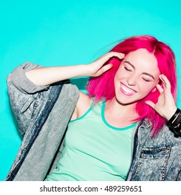 Laughing Teenager girl with pink hair Stylish hair color trend