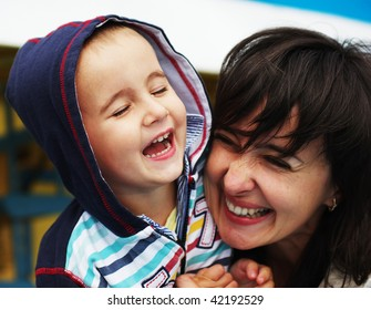 Laughing woman and boy on the boat