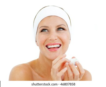 Laughing woman holding a lip balm isolated on a white background
