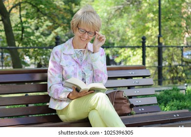 Laughing woman read a book