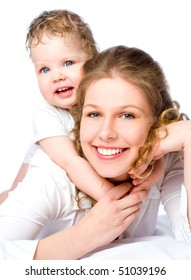 Laughing young mum and the kid on a white