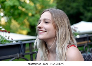 laughing young woman with blond hairs
