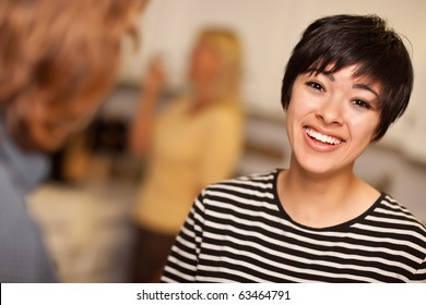 Laughing Young Woman Socializing in a Party Setting.