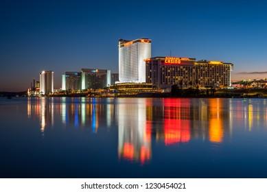 Laughlin, Nevada - November 11, 2018: The Colorado River flows past the hotels and casinos of Laughlin, Nevada at dusk.