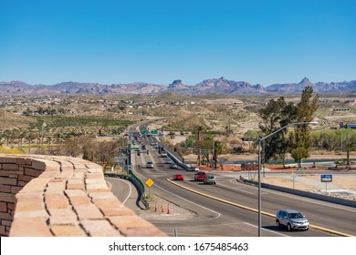 Laughlin, NV / USA – February 19, 2020: A view of Casino Drive and HWY 163 crossing over the Colorado River to Bullhead City, Arizona as seem from Laughlin, Nevada.