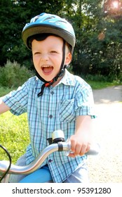 Lauging Child with bike