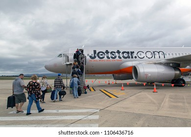 Launceston, Australia: April 01, 2018: Passengers boarding a Jetstar flight to Tullamarine Airport in Melbourne. Jetstar is low-cost airline owned by Qantas. Jetstar is an Australian low-cost airline