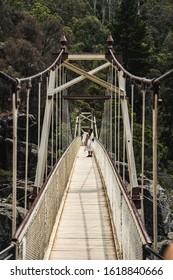 Launceston, Tasmania - January 3rd 2020: Tourist takes a selfie on the Alexandra Suspension Bridge at Cataract Gorge, Launceston Tasmania.