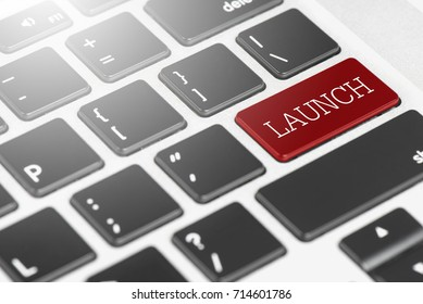 """LAUNCH"" Red button keyboard on laptop computer for Business and Technology concept"