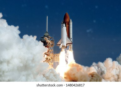 The launch of the space shuttle. With fire and smoke. Against the background of the starry sky. Elements of this image were furnished by NASA