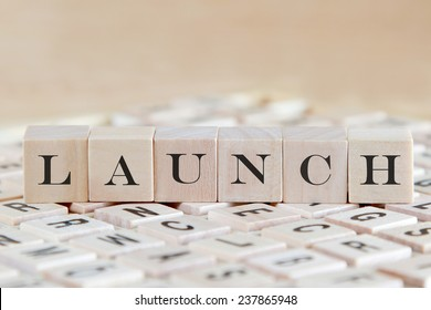launch word background on wood blocks