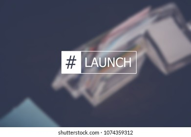 Launch word with business blurring background