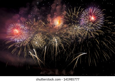 Launching of Colorful fireworks of various colors over night sky