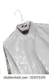 Laundered and pressed shirts on hangers. White background