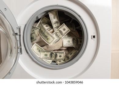 Laundering of dirty money in washing machine. close up. Selective focus.