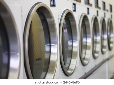laundromat machine washer line with closed doors (shallow depth of field)