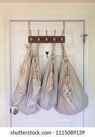 Laundry bags hanging on hooks
