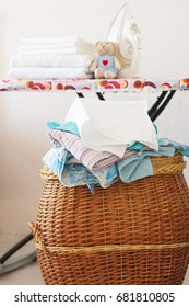 laundry basket and clean ironed  white towels