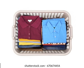 Laundry basket with clothes.On white background basket with clean piled clothes.