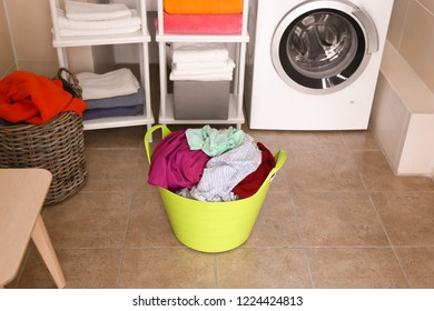 Laundry basket with dirty clothes in bathroom