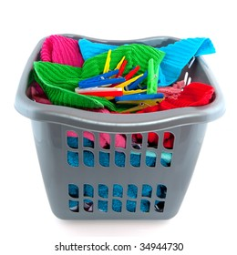laundry basket filled with colorful towels isolated over white