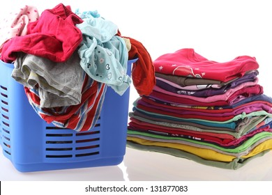 Laundry in basket and ironed clothes, isolated