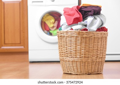 Laundry basket on the background of the washing machine.