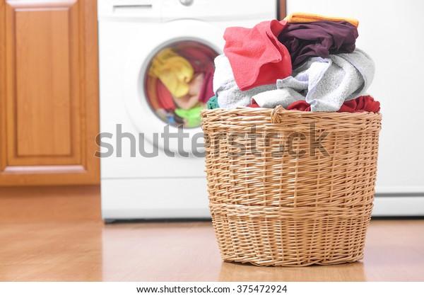 Laundry basket on the background of the washing machine.