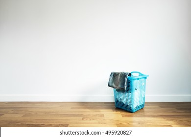 Laundry Basket on Wooden Floor and White Wall