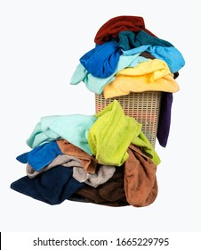 Laundry basket with a pile of towels isolated on white background