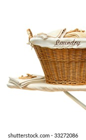 Laundry basket with towels on ironing board against white background