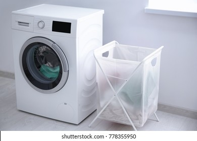 Laundry basket and washing machine indoors