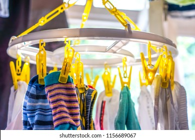 laundry of big family. colorful socks on clothespin