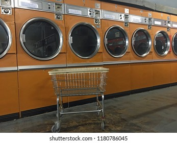 Laundry cart in yellow retro laundromat