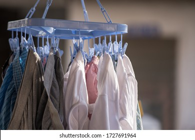 The laundry is cleaned and then dried by clamps and hung in front of the house.