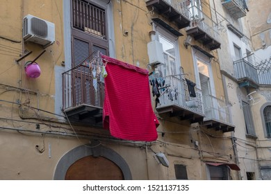 Laundry dries on the balconies. Fragment of a house, Italy.