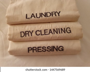 laundry, dry cleaning, pressing sign