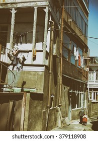 laundry drying in the courtyard of the old house. Retro styled phoro