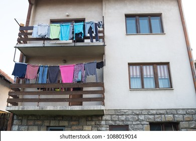 Laundry drying on the balcony of a family house, backyard view, Eastern Europe