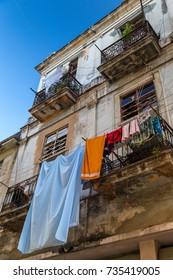 Laundry drying on a balcony in Old Havana street