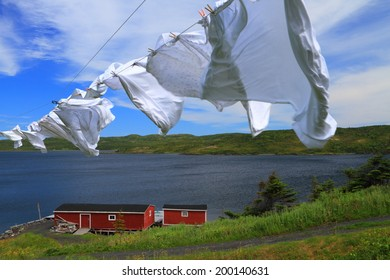 Laundry drying on the clothesline near red cabin in beautiful Nordic landscape