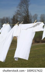 Laundry drying on the rope outside on a sunny day