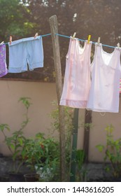 Laundry drying on the wire, in the backyard