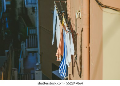 Laundry hanging on a clothes line on an old building in El Carmen district, Barcelona, Spain